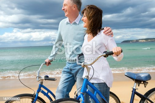 959016450 istock photo Mature couple cycling on the beach 187068690