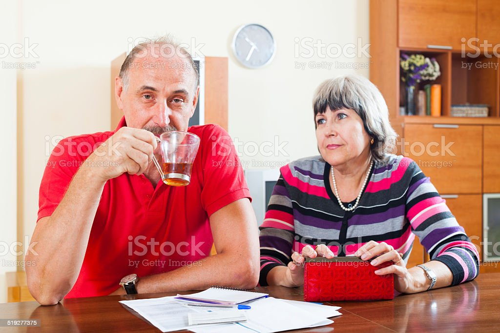 Mature couple did not have the money stock photo