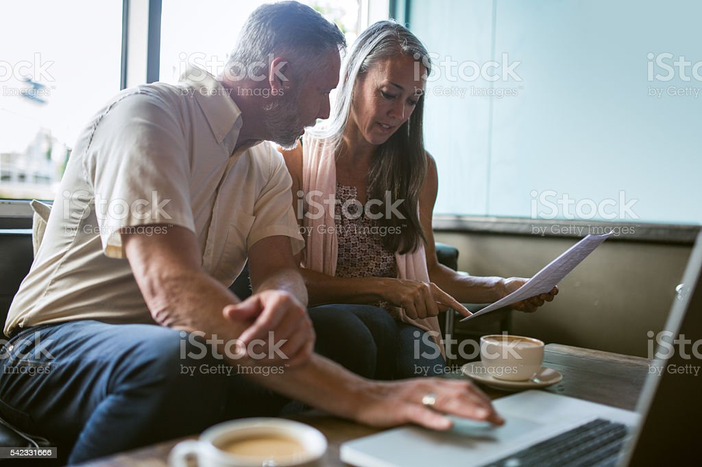 Mature Couple Discussing Finances stock photo
