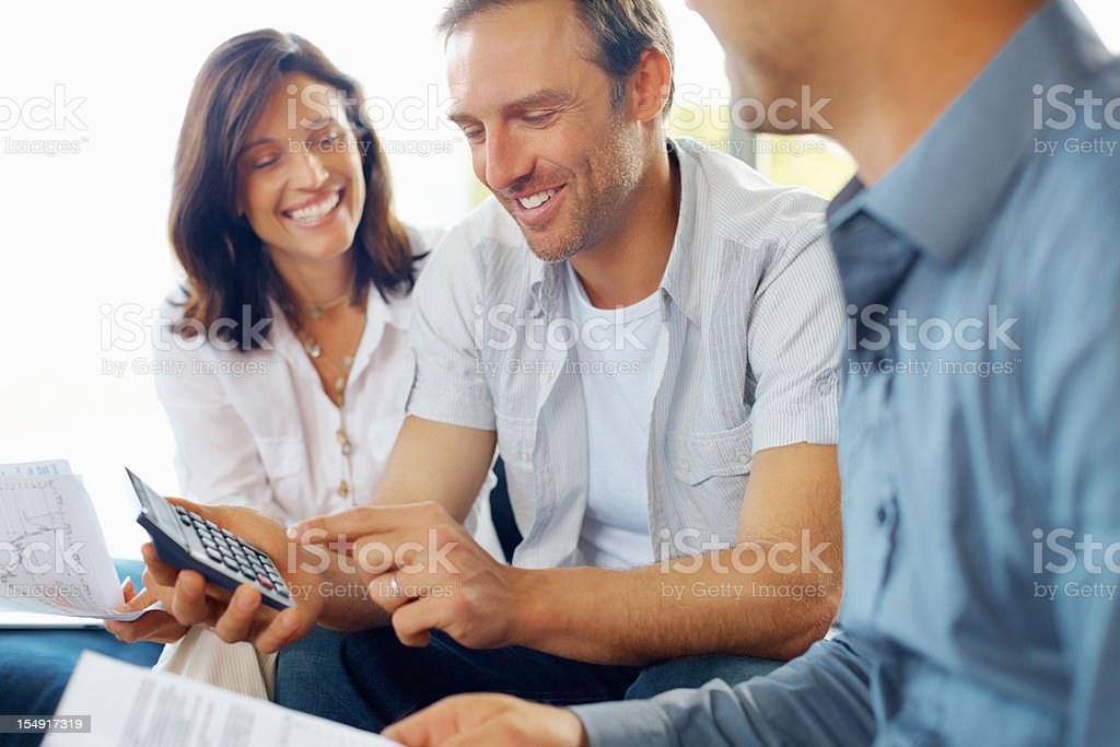 Mature couple discussing financial matter - Royalty-free 30-39 Years Stock Photo