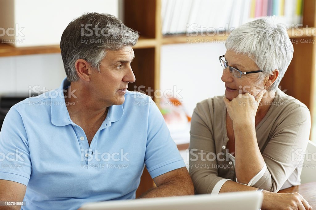 Mature couple discussing their future plans royalty-free stock photo
