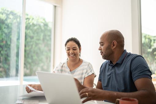 Mature couple doing home finances