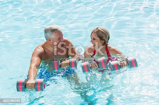 612839448istockphoto Mature couple doing water aerobics 450286535