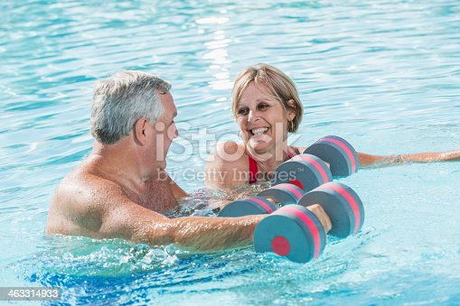 612839448istockphoto Mature couple doing water aerobics 463314933