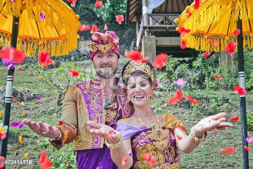 istock mature couple dressed in Balinese costume 472414118