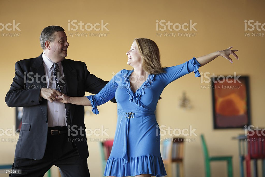 Mature couple dressed in formal attire Ballroom Dancing stock photo