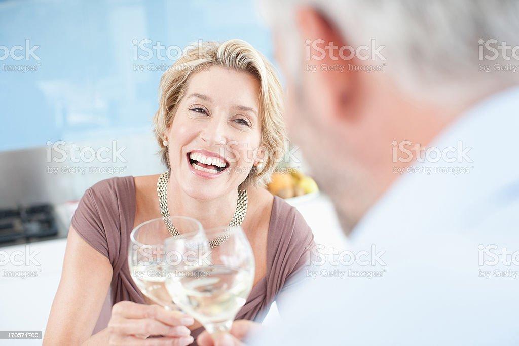 Mature couple drinking white wine stock photo