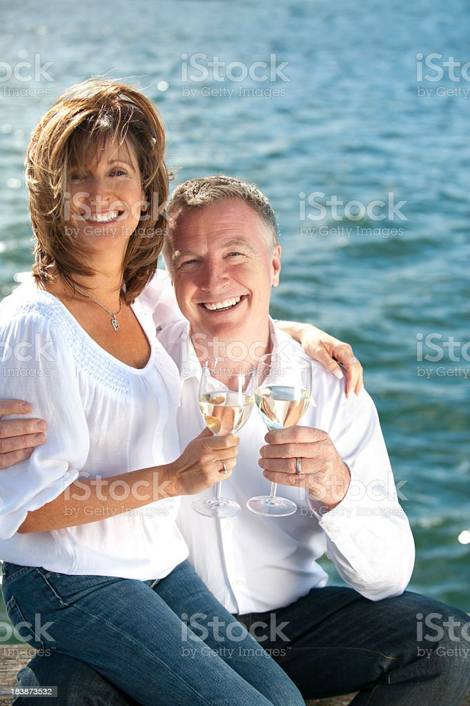 Mature couple drinking wine royalty-free stock photo