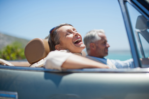 istock Mature couple driving in convertible 170587800