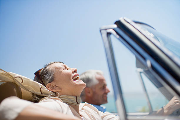 Mature couple driving in convertible  affluent lifestyles stock pictures, royalty-free photos & images