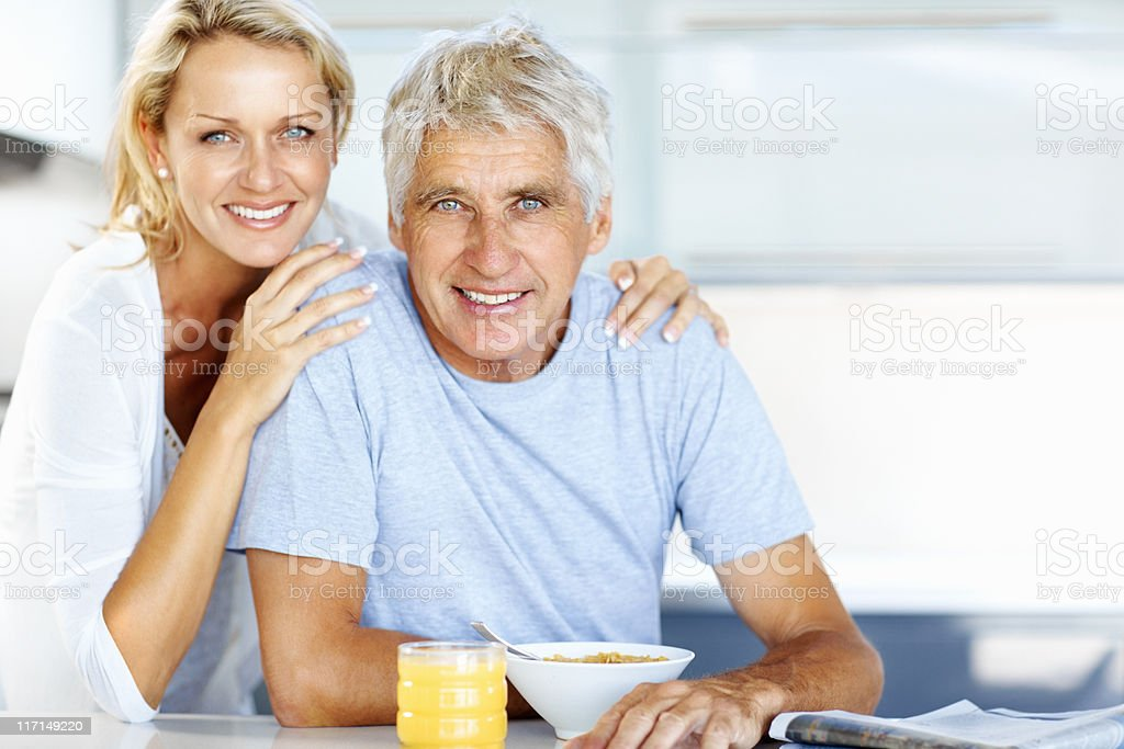 Mature couple eating breakfast royalty-free stock photo