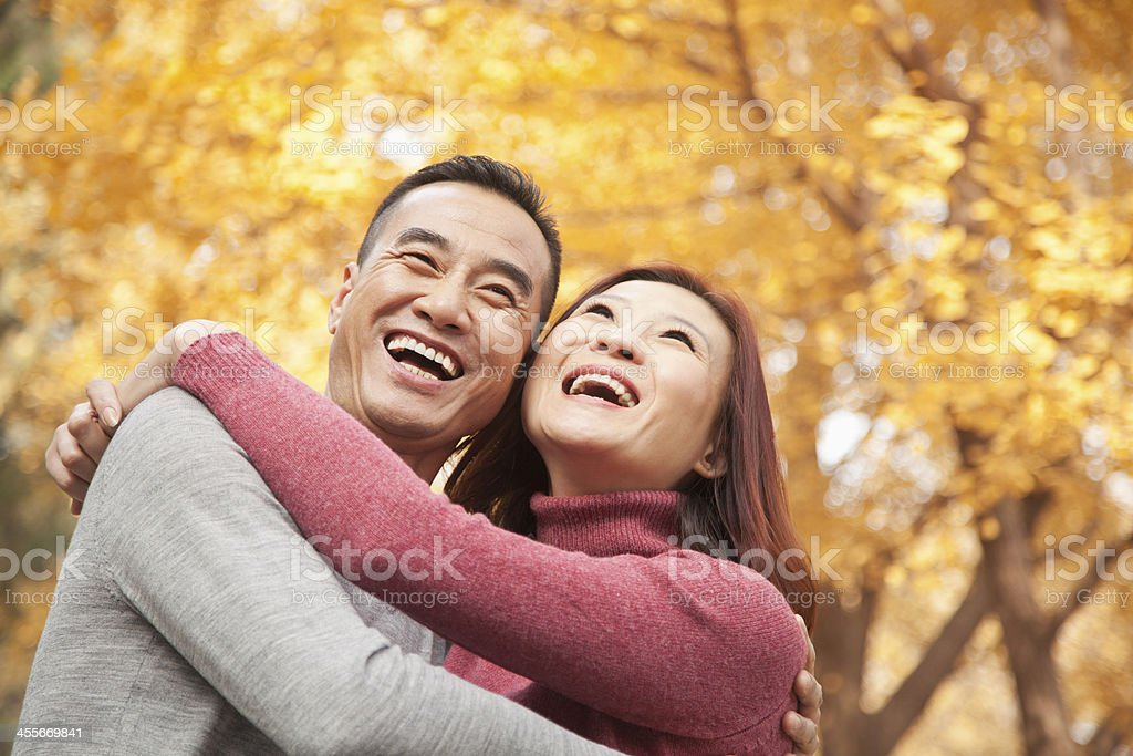 Mature Couple Embracing in Park stock photo