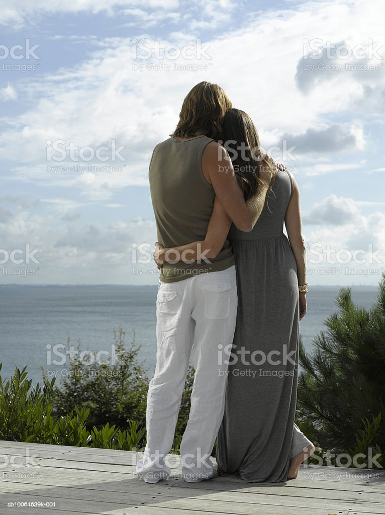 Mature couple embracing, rear view royalty-free stock photo