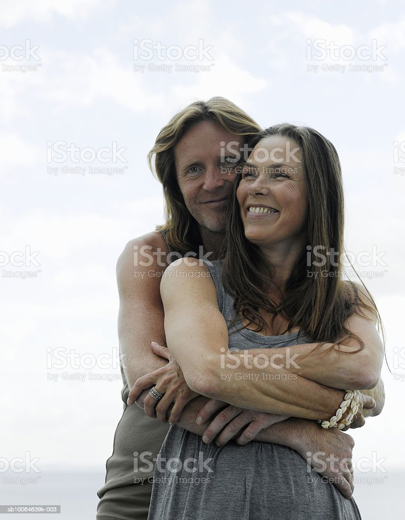 Mature couple embracing, smiling royalty-free stock photo