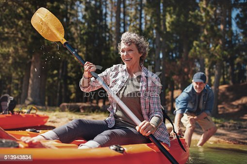 istock Mature couple enjoying a day at the lake with kayaking 513943834