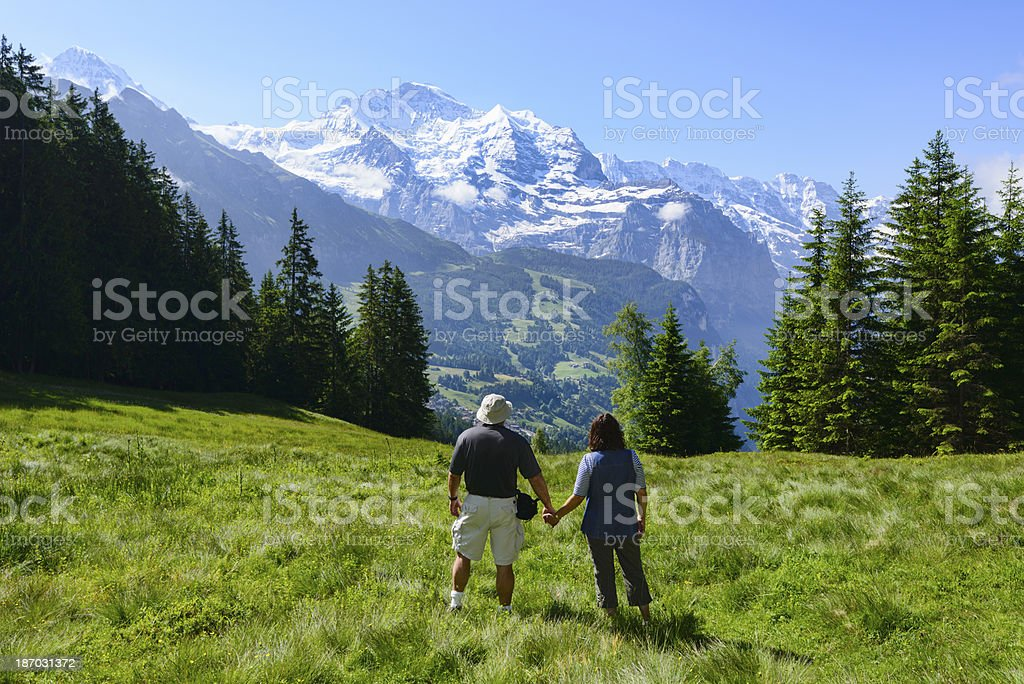 Mature couple enjoying a day in the Swiss countryside -XXXL royalty-free stock photo