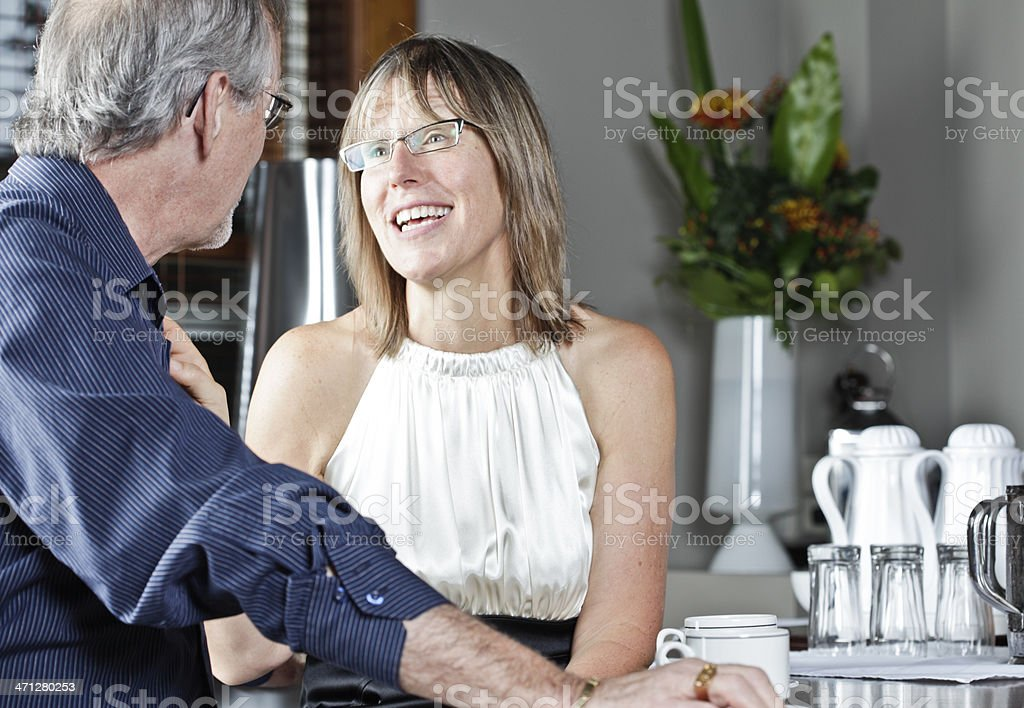 Mature Couple Enjoying Coffee at a Cafe royalty-free stock photo