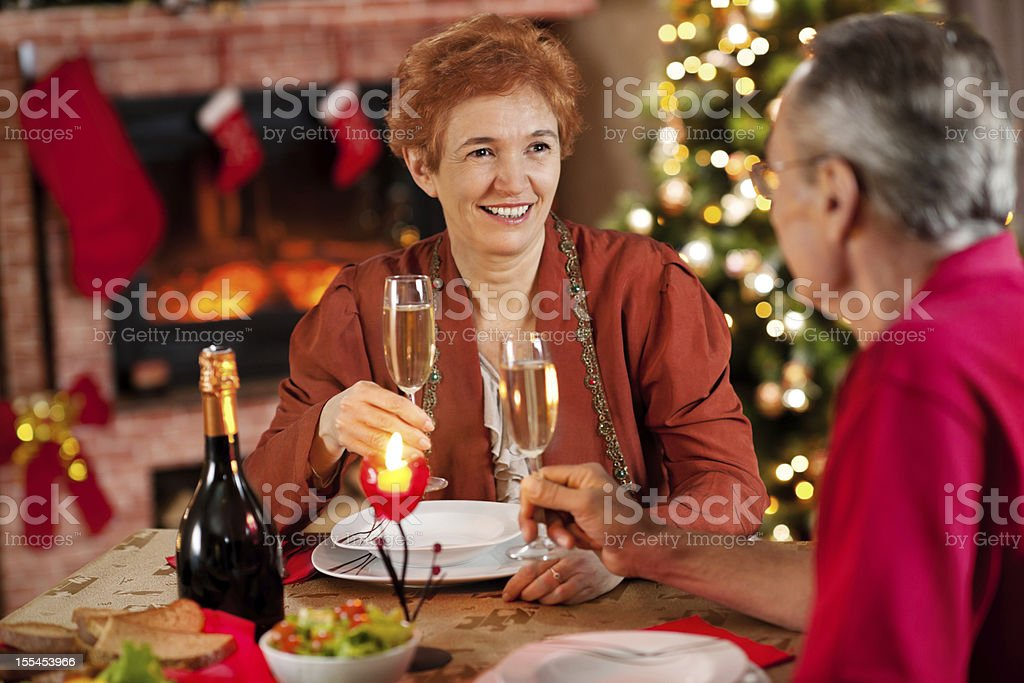 Mature couple enjoying in Christmas dinner. royalty-free stock photo