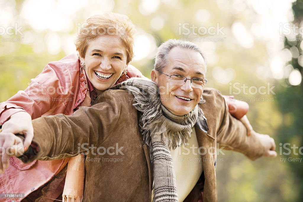 Mature couple enjoying in the park. royalty-free stock photo