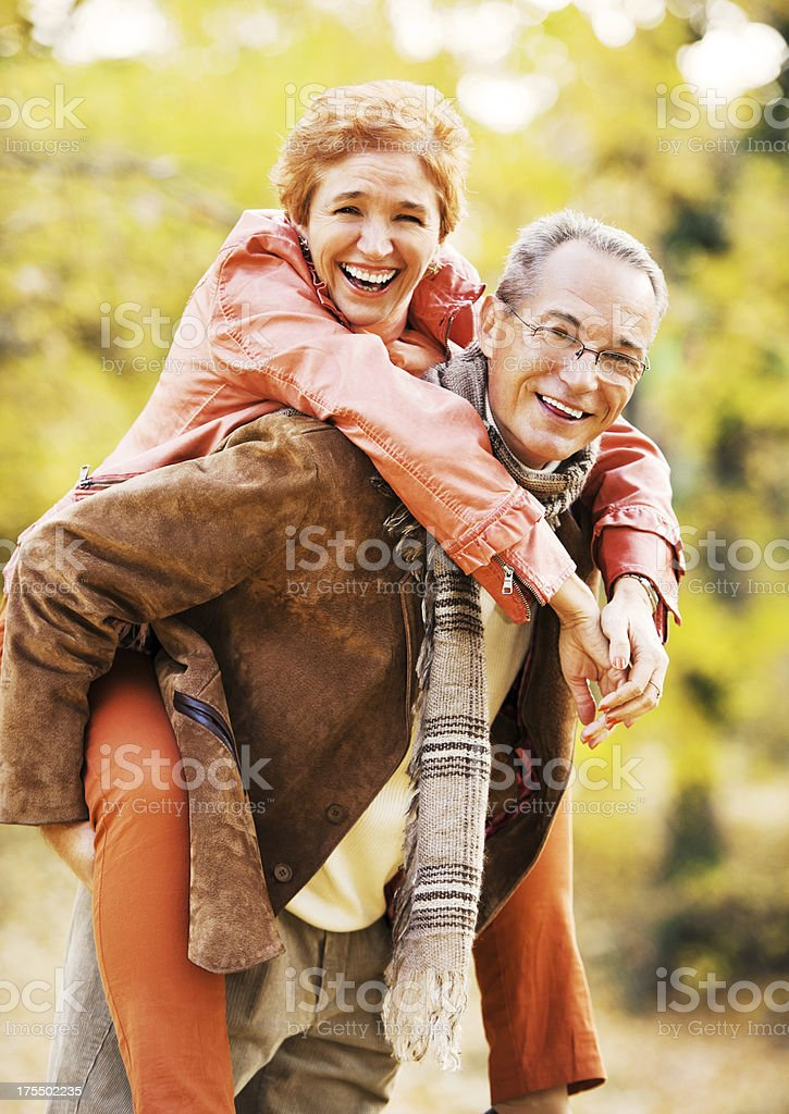 Mature couple enjoying in the park royalty-free stock photo
