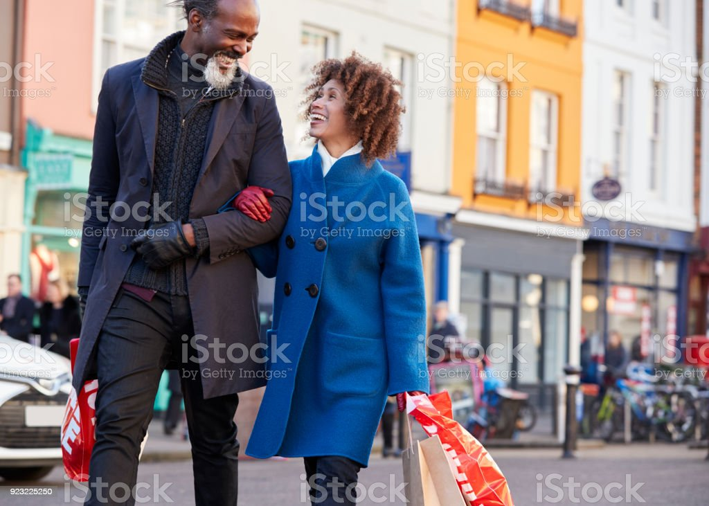 Mature Couple Enjoying Shopping In City Together stock photo