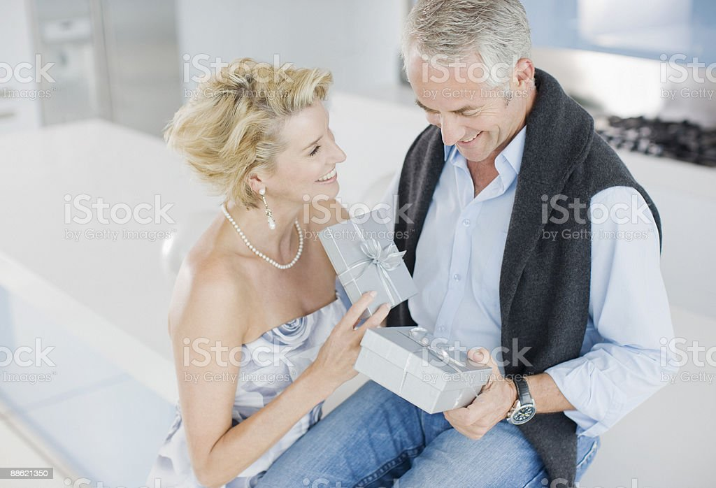Mature couple exchanging anniversary gifts royalty-free stock photo