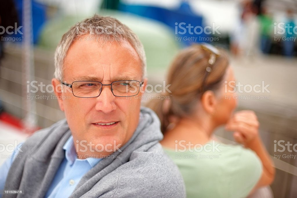 Mature couple facing opposite direction royalty-free stock photo