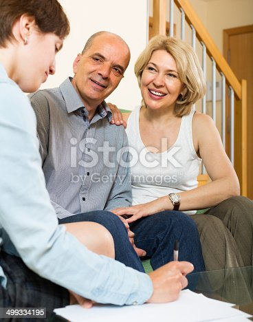 584597964 istock photo Mature couple filling questionnaire 499334195