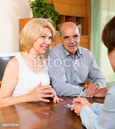 584597964 istock photo Mature couple filling questionnaire 500279243