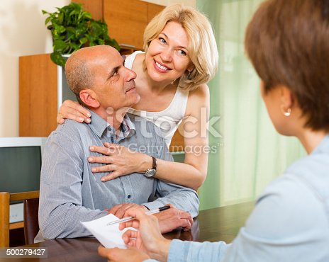 584597964 istock photo Mature couple filling questionnaire 500279427