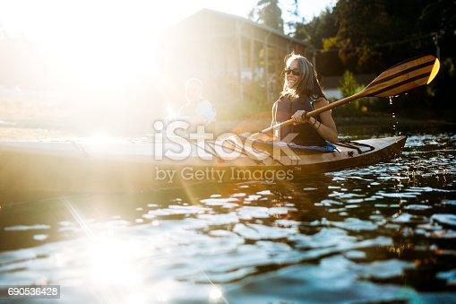 690538774 istock photo Mature Couple Has Fun Kayaking 690536428