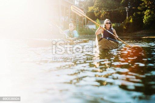 690538774 istock photo Mature Couple Has Fun Kayaking 690538504