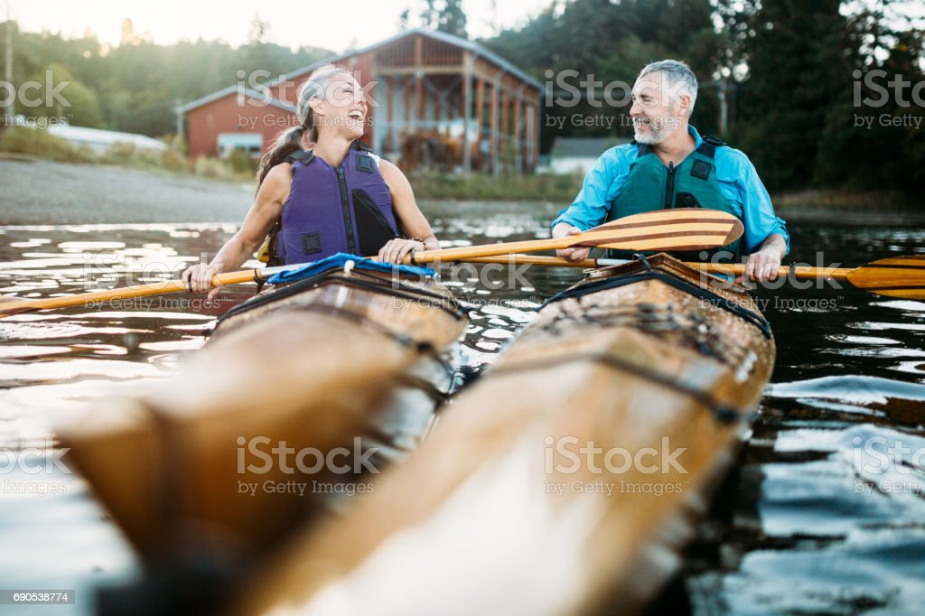 Mature Couple Has Fun Kayaking stock photo