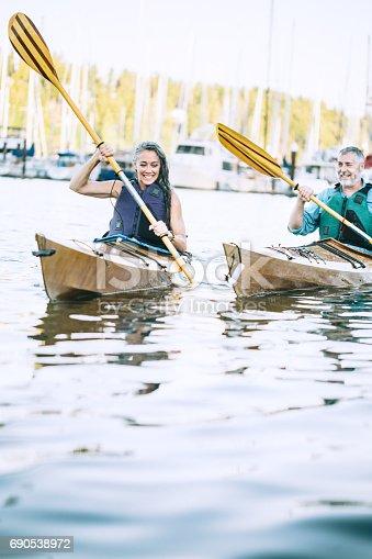 690538774 istock photo Mature Couple Has Fun Kayaking 690538972
