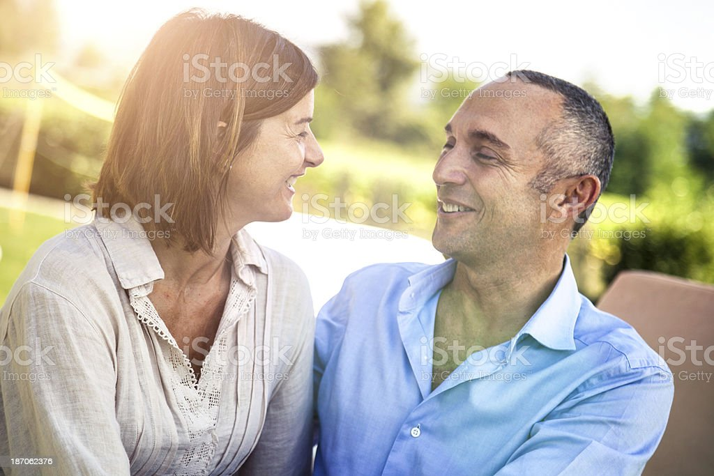 Mature couple have fun in the garden royalty-free stock photo