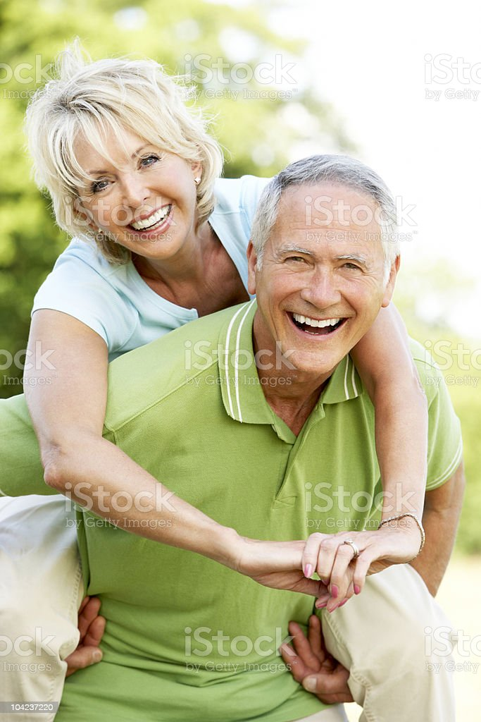 Mature couple having fun in countryside stock photo