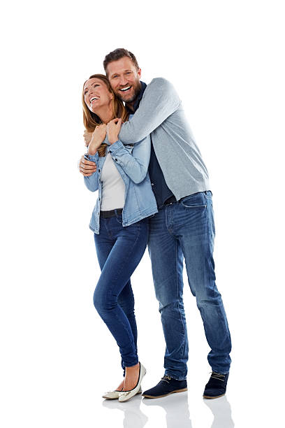 Mature couple having fun on white background stock photo