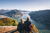 istock Mature couple hike above lake Lugano in the morning 1292251389