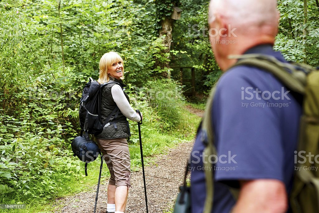 Mature couple hiking in forest royalty-free stock photo