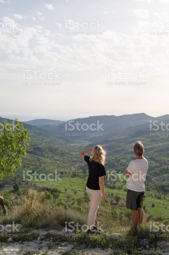 Mature couple hiking in hills, spring royalty-free stock photo