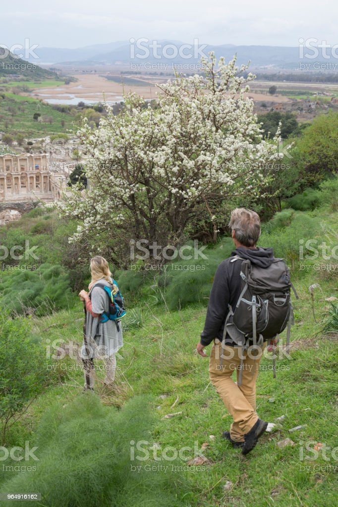 Mature couple hiking in springtime royalty-free stock photo