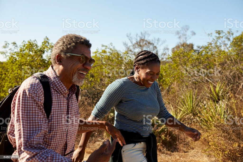 Mature Couple Hiking Outdoors In Countryside Together stock photo
