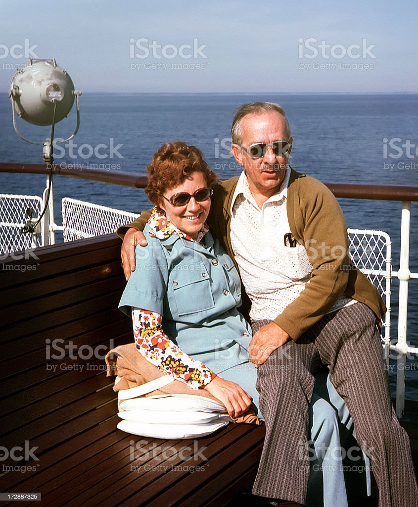 Mature couple holding each other on a boat stock photo