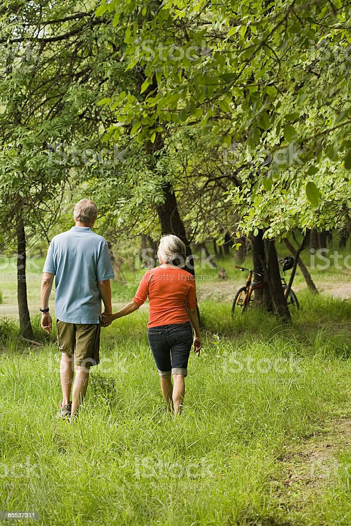Mature couple holding hands royalty-free stock photo