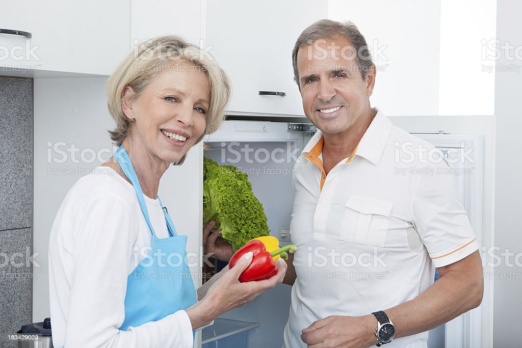 Mature Couple Holding Vegetables royalty-free stock photo