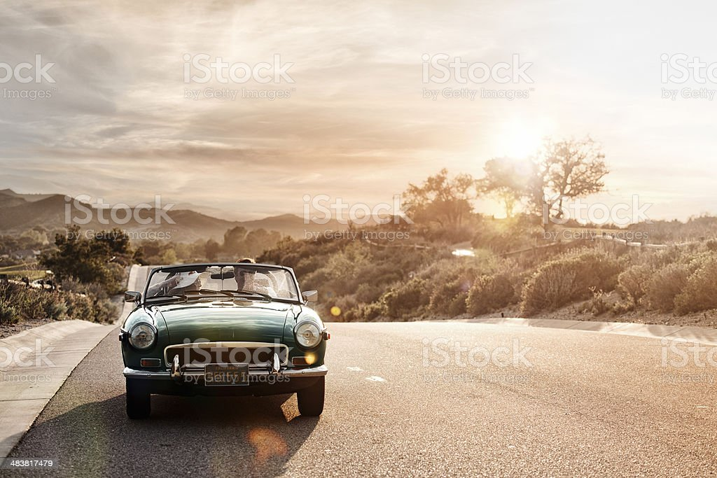 Mature couple in a cabriolet stock photo