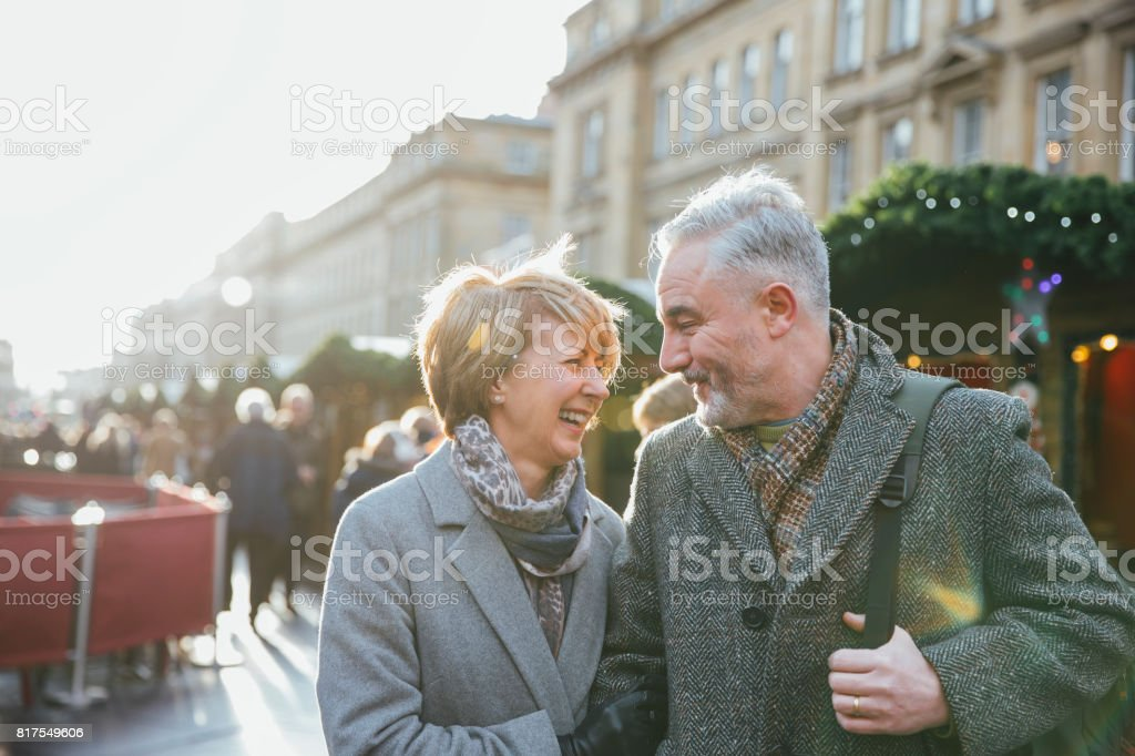 Mature Couple In Christmas Market stock photo