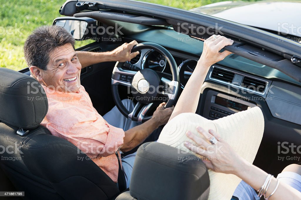 Mature couple in convertible royalty-free stock photo