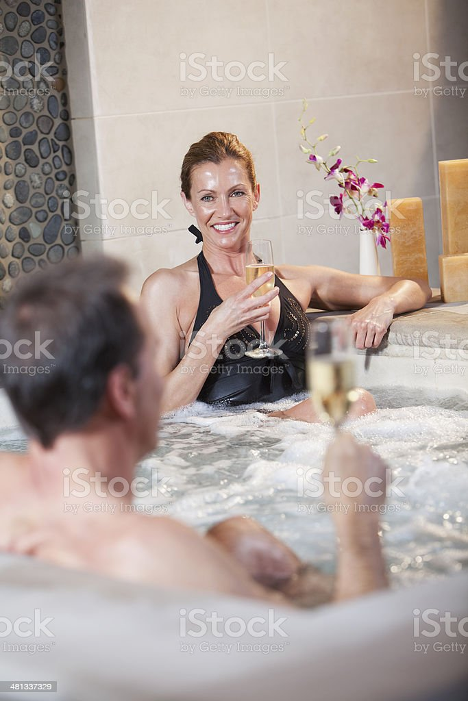 Mature couple in jacuzzi stock photo