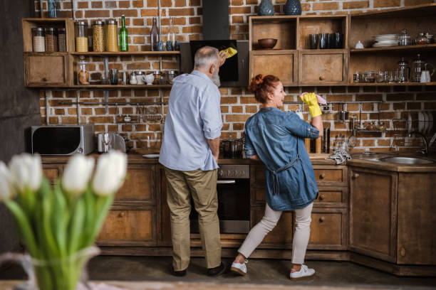 mature couple in kitchen - full length of senior people singing together against white stock photos and pictures